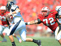 Panther's quarterback Jake Medlock gets by Terrapin's Joe Vellano. Maryland defeated FIU 42-28 during a game at Capital One Field at Byrd Stadium in College Park, MD on Saturday, September 25, 2010. Alan P. Santos/DC Sports Box