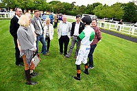 Jockey Dougie Costello keeps the connections of Cecilator amused in the parade ring  during Afternoon Racing at Salisbury Racecourse on 18th May 2017