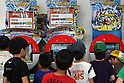 May 9, 2010 - Tokyo, Japan - Young Japanese boys look at games on display in the official Pokemon store in Tokyo on May 9, 2010. Nintendo recently announced that the DS handheld device had become the best selling gaming handheld of all time, with a total of 129 million units sold. The DS 'family' have surpassed the &quot;Game Boy&quot; series which hit 118 million over two decades.