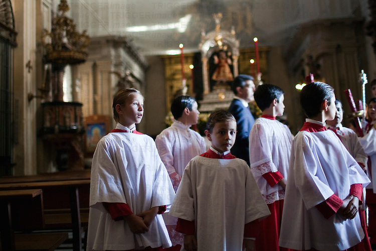 Altar boys, Sagrario church, Corpus Christi procession, Seville, Spain, 2009.