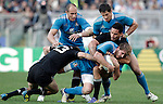 Rugby: test match Italia vs Nuova Zelanda. Roma, stadio Olimpico, 17 novembre 2012..Italy's Mirco Bergamasco, bottom right,  is tackled by New Zealand's Conrad Smith, bottom left, and Hosea Gear, during an international rugby test match between Italy and New Zealand at Rome's Olympic stadium, 17 November 2012..UPDATE IMAGES PRESS/Riccardo De Luca