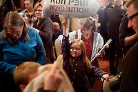 A young girl holds a &quot;Ron Paul Revolution&quot; blimp balloon at a Ron Paul town hall meeting and rally at the Church Landing at Mills Falls hotel in Meredith, New Hampshire, on Jan. 8, 2012. Paul is seeking the 2012 Republican presidential nomination.