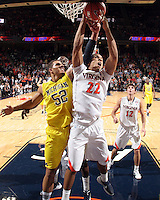 CHARLOTTESVILLE, VA- NOVEMBER 29: Malcolm Brogdon #22 of the Virginia Cavaliers reaches for the rebound with Jordan Morgan #52 of the Michigan Wolverines during the game on November 29, 2011 at the John Paul Jones Arena in Charlottesville, Virginia. Virginia defeated Michigan 70-58. (Photo by Andrew Shurtleff/Getty Images) *** Local Caption *** Malcolm Brogdon;Jordan Morgan