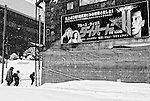 A mother and two children walk past a poster for the film Die Hard in Yubari City, on the northernmost island of Hokkaido in Japan. Among Yubari's claims to fame is an international film festival, which was once a local government-run event frequented by the likes of Quentin Tarrantino.