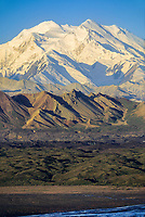 Mount McKinley, (Denali) North and South peaks of North America's highest mountain, summer, Muldrow glacier moraine and Thorofare river in foreground, Denali National Park, Alaska