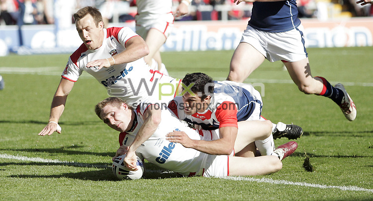 PICTURE BY VAUGHN RIDLEY/SWPIX.COM - Rugby League - International - England v France - Leigh Sports Village, Leigh, England - 12/06/10...Copyright - Simon Wilkinson - 07811267706...England's Sam Tomkins scores a try.