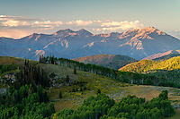 Warm late Summer sunrise lights up the peaks of the Wasatch Mountains on Guardsman Pass in Utah.