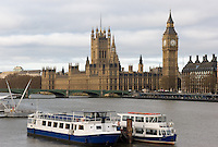 Tour boats on the Thames with the Houses of Parliament and Big Ben in the background, London, England