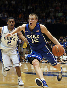 "Freshman Alex Murphy (12) moves past Quinn Cook (2) as he eyes the net. Duke has five freshman on the team this year. Duke men's basketball had an opening scrimmage game as a part of the ""Countdown to Craziness"" event at Cameron Indoor Stadium Friday Oct. 14, 2011.  Photo by Al Drago..."