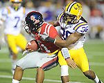 Ole Miss' Barry Brunetti(11) is tackled by LSU safety Derrick Bryant (36) at Vaught-Hemingway Stadium in Oxford, Miss. on Saturday, November 19, 2011..