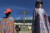 Two larger-than-life statues called gigantes are meant to represent the indigenous population of San Antonio de Jesús, Guatemala. They gigantes were set out early in the central square in preparation for the town's annual celebration for its patron saint on Thursday, June 13, 2002
