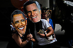 People masked as US President Barack Obama(L) and Republican candidate Mitt Romney take part in a march while protesters of the Occupy Wall Street movement celebrate their first anniversary with marches and confrontations with the New York police where 150 protesters have been arrested during weekend celebrations in Manhattan.  Photo by Eduardo Munoz Alvarez / VIEWpress.