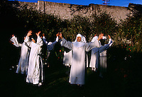 Novices studying to become nuns sing in the garden behind the walls of Santa Catalina Convent. The young cloistered nuns are allowed a break in their silence as they learn the strict life in a convent. Seven times during the day the nuns go to their chapel for chorus and pray. Contemplation is the most important thing in their lives and as well as study.<br />