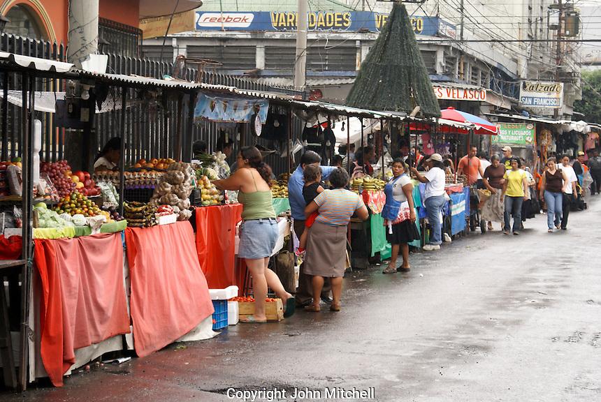 Fruit and produce stalls lining a street in downtown San Salvador, El Salvador