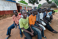 N. Uganda, Kitgum. Much of PCAF's work is focused on aiding child soldiers. These young men, now in their late teens, have lived through unspeakable horrors of abuse and violence since their abduction as children. Many witnessed most of their family members killed. They now struggle to assimilate back into the community suffering PTSD & depression, alcohol & drug abuse. A PCAF social worker, Joseph Bongomin, visits with them for individual counseling and group therapy in their community.