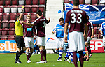 Hearts v St Johnstone...04.08.12.Ryan McGowan is booked by ref Stevie O'Reilly after leading with the elbow in a challenge on Callum Davidson..Picture by Graeme Hart..Copyright Perthshire Picture Agency.Tel: 01738 623350  Mobile: 07990 594431