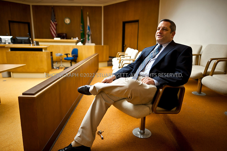 2/11/2011--Olympia, WA, USA..Thurston County prosecutor Rick Peters posing in one of the Thurston County courtrooms in Olympia, WA. In 2010, Peters charged 3 juveniles in a 'sexting' case in which a  14 year old girl took a nude photo of herself and sent it to her boyfriend. Three teens were arrested after they sent the naked photo of girl onto friends and it eventually went viral across Thurston County...©2011 Stuart Isett. All rights reserved.