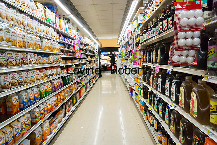"""A well stocked supermarket in New York is seen on Sunday, August 21, 2016. """"Food at home"""" prices, government speak for grocery store prices,  have been declining, falling 1.6% over the last year, while, """"food away from home"""", restaurant prices, has been rising causing more consumers to eat at home than dine out.  (© Richard B. Levine)"""