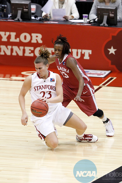 04 APR 2010:  Stanford University guard Jeanette Pohlen (23) loses her footing as she is chased by University of Oklahoma guard Danielle  Robinson during the Division I Women's Basketball Semifinals held at the Alamodome during the 2010 Women's Final Four in San Antonio, TX.  Stanford defeated Oklahoma by a score of 73-66.  Trevor Brown, Jr./NCAA Photos