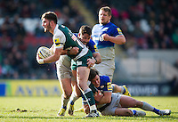 Owen Williams of Leicester Tigers is double-tackled by Brad Barritt and Nils Mordt of Saracens. Aviva Premiership match, between Leicester Tigers and Saracens on March 20, 2016 at Welford Road in Leicester, England. Photo by: Patrick Khachfe / JMP