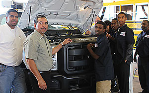 Sterling High School students in the automotive internship program pose with their mentors from the Transportation Services department.