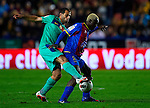 Levante's Kone (R) vies for the ball with FC Barcelona's Javier Mascherano (L) during the Spanish league football match Levante UD vs FC Barcelona on April 14, 2012 at the Ciudad de Valencia Stadium in Valencia. (Photo by Xaume Olleros/Action Plus)