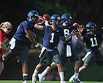 Ole Miss quarterbacks Evan Ingram (19), Randall Mackey (1), Zack Stoudt (8) and Barry Brunetti (11) go through a drill at  football practice in Oxford, Miss. on Sunday, August 7, 2011.