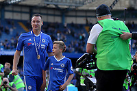 Chelsea's John Terry walks around the edge of the pitch with his son before heading to the home dressing room for the last time as a Chelsea player during Chelsea vs Sunderland AFC, Premier League Football at Stamford Bridge on 21st May 2017