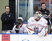 Matt Nareski (Northeastern - Equipment Manager), Garrett Vermeersch (Northeastern - 9), Bryan Mountain (Northeastern - 46), Steve Clark (Northeastern - Trainer) - The visiting Niagara University Purple Eagles defeated the Northeastern University Huskies 4-1 on Friday, November 5, 2010, at Matthews Arena in Boston, Massachusetts.