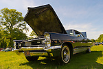Old Westbury, New York, U.S. - June 1, 2014 -  A black 1966 Pontiac Grand Prix, owner CHRIS ENGEL OF GARDEN CITY PARK, is an entry at the Antique and Collectible Auto Show held on the historic grounds of elegant Old Westbury Gardens in Long Island, and sponsored by Greater New York Region AACA Antique Automobile Club of America.