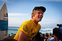 HONOLULU/Oahu/Hawaii.(Dec 2, 2011) -- John John Florence (HAW).  The $250,000 Vans World Cup of Surfing wrapped up today in 10 -12' -foot surf at Sunset Beach on Oahu's North Shore. Local surfer John John Florence (HAW) took out the final from Michel Bourez (PYF) in second, Australia's Adam Melling in third and Hank Gaskell (HAW) in fourth. The final was a barrel riding contest with the lead changing a number of times before Florence combo the firld with two long deep tubes. Waves were in the mid size range for most of the day with strong side shore Trade winds. The Vans World Cup is the second leg of the 29th annual Vans Triple Crown of Surfing, presented by Rockstar Energy Drink.. Photo: joliphotos.com