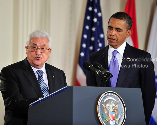 President Mahmoud Abbas of the Palestinian Authority makes remarks as United States President Barack Obama looks on in the East Room of the White House following a series bi-lateral meetings in Washington, D.C. on Wednesday, September 1, 2010.  The statements are in advance of the opening of the first direct talks in two years between Israel and the Palestinian Authority scheduled to begin at the State Department in Washington, D.C. tomorrow.  .Credit: Ron Sachs / Pool via CNP.(RESTRICTION: NO New York or New Jersey Newspapers or newspapers within a 75 mile radius of New York City)