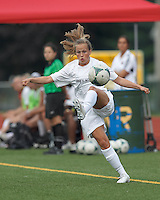 Boston Aztec forward Tori McCombs (5) collects a pass.  In a Women's Premier Soccer League (WPSL) match, Boston Aztec (white) defeated Seacoast United Phantoms (blue), 3-0, at North Reading High School Stadium on Arthur J. Kenney Athletic Field on on June 25, 2013.