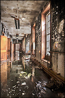 Flooded corridor with windows and doors