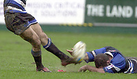 31/01/2004 Parker Pen Challenge Trophy.Bath Rugby v Beziers.Olly Barkley kicks the ball in the wind as Steve Borthwick holds steady...   [Mandatory Credit, Peter Spurier/ Intersport Images].