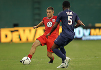 WASHINGTON, DC - July 28, 2012:  Chris Kolb (22) of DC United knocks the ball past Siaka Tiene (5) of PSG (Paris Saint-Germain) in an international friendly match at RFK Stadium in Washington DC on July 28. The game ended in a 1-1 tie.