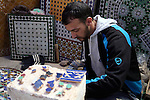 Africa, Morocco, Fes. Moroccn mosaic artisan.