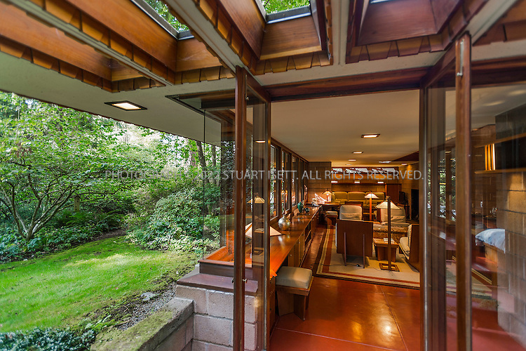 "10/9/2012--Sammamish, WA, USA..VIEW: Exterior showing living room...Architect Frank Lloyd Wright planned his ""Usonian"" homes to be affordable for middle-class families. The 1,9500 square foot Brandes home is for sale in Sammamish, Washington (30 minutes from Seattle) at $1.39 million. It features three bedrooms, two bathrooms and a small, separate office/study space...The home was built in 1952, and has redwood trim and Wright's original furniture and some garden sculptures by Wright. It's one of only three Frank Lloyd Wright homes near Seattle...©2012 Stuart Isett. All rights reserved."