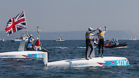ENGLAND, Weymouth. 10th August 2012. Olympic Games. Men's 470 class. Medal Race. Mathew Belcher (AUS) Skipper, Malcolm Page (AUS) Crew winners of the Gold Medal with Luke Patience (GBR) Skipper, Stuart Bithell (GBR) Crew, Silver medalists in the background.