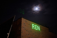 "Ron Paul supporters shine a laser that says ""Ron Paul 2012"" onto a building at the site of the GOP debate at St. Anselm College in Manchester, New Hampshire, on Jan. 7, 2012."