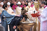 Pope Benedict XVI holds a candle during the Easter vigil mass in Saint Peter's Basilica, in the Vatican, late 03 April 2010.