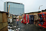 A girl runs through an illegal Roma settlement in Belgrade, Serbia, in February 2012. The families that lived here, most of whom survive from recycling cardboard and other materials, were forcibly evicted in April 2012. Many were moved into metal shipping containers on the edge of Belgrade.