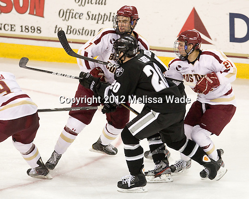 Isaac MacLeod (BC - 7), Shane Luke (PC - 20), Steven Whitney (BC - 21) - The Boston College Eagles defeated the Providence College Friars 7-0 on Saturday, February 25, 2012, at Kelley Rink at Conte Forum in Chestnut Hill, Massachusetts.