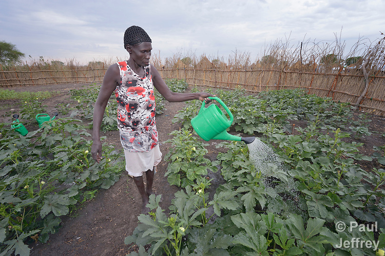Abul Yak waters plants in a communal vegetable garden in Poktap, a town in South Sudan's Jonglei State where conflict, drought and inflation have caused severe food insecurity. Most families in the town have just returned from years of displacement. The Lutheran World Federation, a member of the ACT Alliance, is helping families tackle food problems, and provided seeds and tools to help Yak and her neighbors start the garden.
