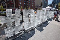 An ice sculpture by the Dark Snow Project covered in soot is seen at an Earth Day fair in Union Square Park in New York on Sunday, April 21, 2013.  The Dark Snow Project contends that the ice melt of the glaciers in Greenland is caused by black carbon soot from wild fires and industrial pollution covering the ice and warming it up. If the melting of the ice sheet cannot be slowed sea levels could conceivably rise over six feet by the end of the century exacerbating coastal flooding   (© Richard B. Levine)