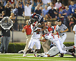 Ole Miss running back Rodney Scott (2) hurdles Fresno State's Desia Dunn (24) and Fresno State's Derron Smith (13) on a 21 yard run in the fourth quarter at Vaught-Hemingway Stadium in Oxford, Miss. on Saturday, September 25, 2010. Ole Miss won 55-38.