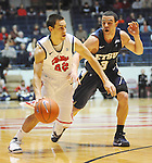 "Mississippi's Marshall Henderson (22) drives against East Tennessee State's Mario Stramaglia (3) at the C.M. ""Tad"" Smith Coliseum in Oxford, Miss. on Saturday, December 14, 2012.  (AP Photo/Oxford Eagle, Bruce Newman).."
