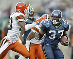 Seattle Seahawks' running back Shaun Alexander rushes against the Cleveland Browns on Sunday, Nov. 30, 2003 at  QWEST Field in Seattle. Jim Bryant Photo. ©2010. All Rights Reserved...