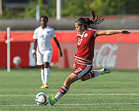 Moncton, New Brunswick - June 13, 2015: In a FIFA Women's World Cup Canada 2015 Group F match, England (white) defeated Mexico (maroon), 2-1, at Moncton Stadium.<br /> .