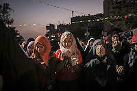 In this Friday, Jul. 12, 2013 photo, female Muslim supporters of the ousted president Mohammed Morsi offer prayers in the streets nearby Al Rabaa mosque in Nasr City, Cairo. (Photo/Narciso Contreras).